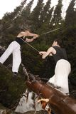 Two man fencing. Two guys fencing with katanas Stock Images