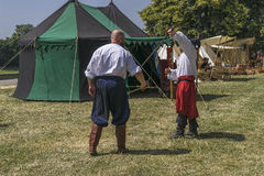 Two Man fight in medieval costume. In Krakow at the time of the fair on the occasion of the feast of Saint John. They train to fight on the Vistula near Wawel Royalty Free Stock Image