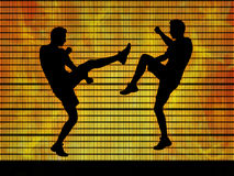 Two man fighting on a fire background. Silhouettes of two young white men fighting in the ring on hot fire background Stock Images