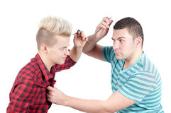 Two man fighting with scissors Royalty Free Stock Photography