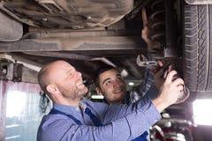 Two man fixing car Stock Photos