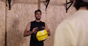 Two Man In Gym Sport Exercising Throw Ball Crossfit Training, Young Sportsman Working Out stock video footage