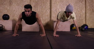 Two Man In Gym Sport Exercising Young Guys Doing Press Push Ups Crossfit Training, Sportsman Working Out stock video