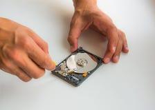 Fixing damaged hard disc using screwdriver stock images
