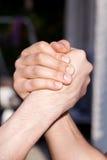 Two man hands handshaking Stock Photos