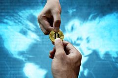 Two man hands holding bitcoin stock image