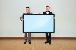 Two man holding plasma Stock Photos