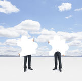 Two man holding puzzle Royalty Free Stock Images