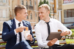 Two man during lunch break Stock Photography