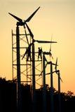 Wind turbine maintenance. Two man maintenance wind turbine silhouette Stock Images