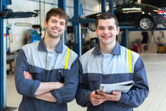Two man mechanics working. Two men mechanics working in car repair service Royalty Free Stock Image