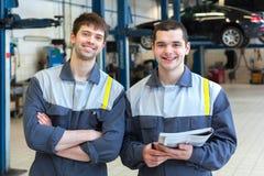 Two man mechanics working Royalty Free Stock Image