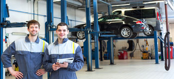 Two man mechanics working Royalty Free Stock Images