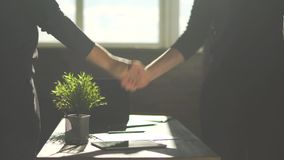 Two man in the office shook hands after business agreement. Male hands shaking each other. Men greet each other with a. Two man in the modern office shook hands stock video