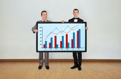 Two man and plasma with graph Stock Photography