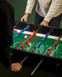 Two man playing foosball game Royalty Free Stock Image