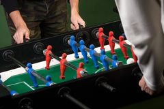 Two man playing foosball game Royalty Free Stock Photo