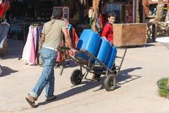 Two man pushing cart Royalty Free Stock Image