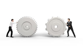 Two man pushing gears Stock Photo