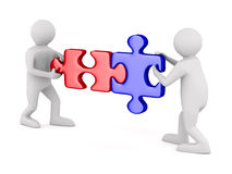 Two man with puzzle on white background Royalty Free Stock Photo