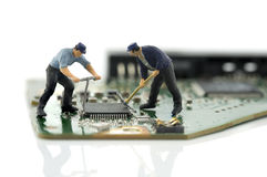 Two man repair chips Royalty Free Stock Images