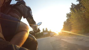 Two man rides on motorcycle at country road in high speed at sunset. Friends going on bike forward to the sun in high stock footage