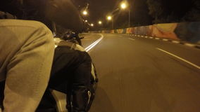 Two man rides on motorcycle in evening town road in high speed. Friends going on bike in the night empty city streets stock video