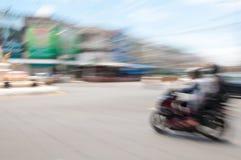 Two man riding motorcycle. blur image Stock Image