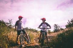 Two Man Riding Mountain Bike on Dirt Road at Daytime royalty free stock image