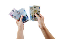 Two man's arms are holding euro money bills Stock Photo