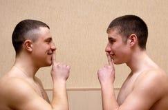 Two man silence stock photo