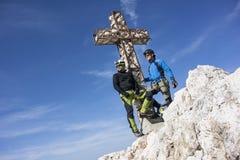 Two men on top of the mountain Stock Photos