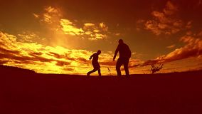 Two man soccer player playing with ball during sunset outdoors silhouette slow motion video . men playing European. Soccer on nature sunset sunlight silhouette stock video footage