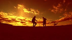 Two man soccer player playing with ball during sunset silhouette slow motion video. men playing European outdoors soccer. On nature sunset sunlight silhouette stock video