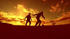 Two man soccer player playing with ball during sunset silhouette slow motion video. men playing European soccer outdoors. On nature sunset sunlight silhouette stock video footage