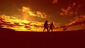 Two man soccer player playing with ball during sunset silhouette slow motion video. men playing European soccer on. Nature sunset sunlight outdoors silhouette stock footage