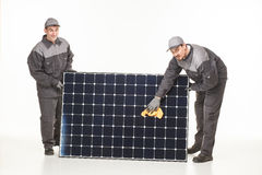 Two man with solar battery Stock Images