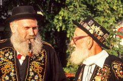 Two man speaking dressed in traditional Swiss costume stock photo