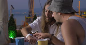 Two man are speaking about smart watch and reseaching it Thessaloniki, Greece stock video