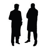 Two man in suits black silhouette on white Stock Photos