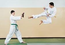 Two man at taekwondo exercises Royalty Free Stock Photo