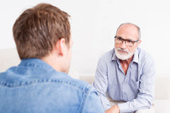 Two man talking royalty free stock photography