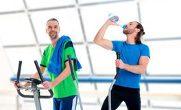 Two man train with fitness machine. Two young men train with fitness machine stock image