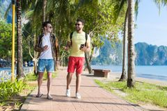 Two Man Using Cell Smart Phones Tropical Park Couple Chatting Online Holiday Sea Summer Vacation. Ocean Travel Royalty Free Stock Photo