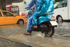 Two man wearing raincoat riding motorcycle. File of two man wearing raincoat riding motorcycle royalty free stock photo