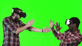 Two man wearing VR googles on green screen stock footage