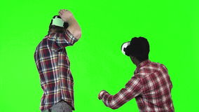 Two man wearing VR googles on green screen stock video