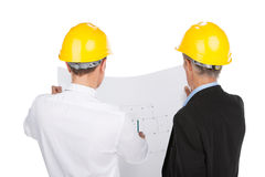 Two man wearing yellow helmets. Royalty Free Stock Photo