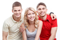 Two man and woman on white isolated background. Happy company. Smiling young blond-haired women and two guys sitting on white isolated background stock photos