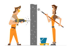 Two man worker drill and paint a wall Stock Photo